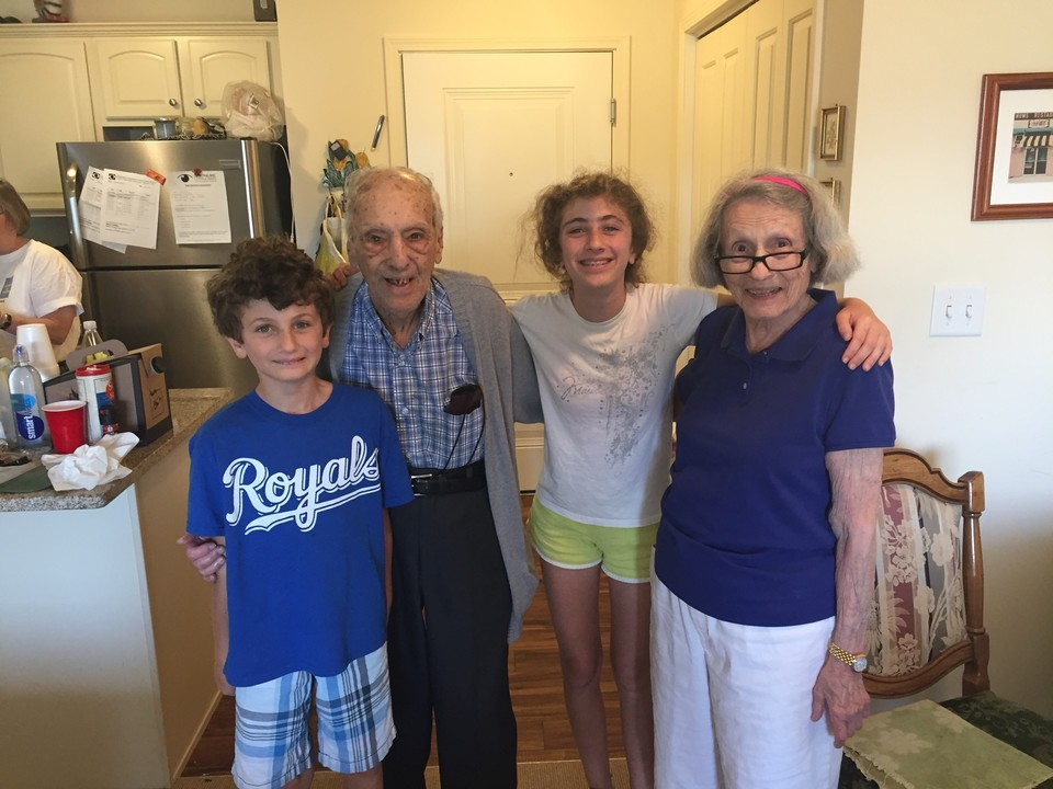Grandchildren Embracing Grandparents