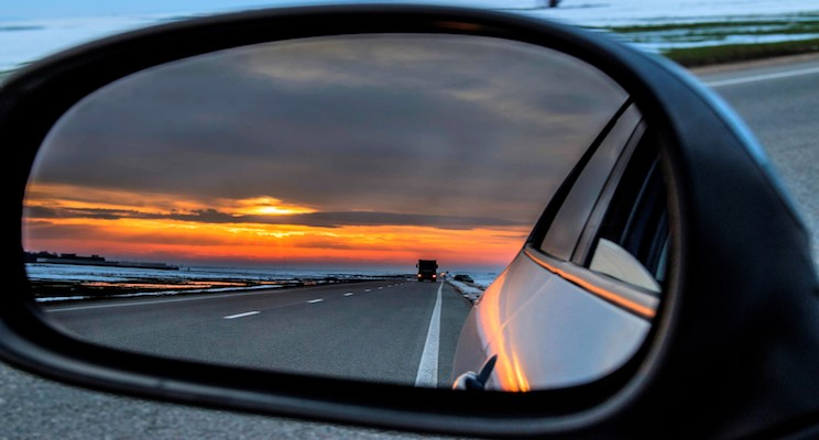sunset reflected in car side mirror